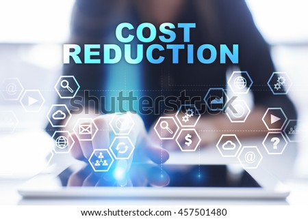 "Woman is using tablet pc, pressing on virtual screen and select ""Cost reduction"". - stock photo"