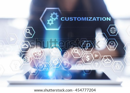 "Woman is using tablet pc, pressing on virtual screen and select ""Customization"". - stock photo"