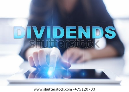 "Woman is using tablet pc, pressing on virtual screen and select ""Dividends""."