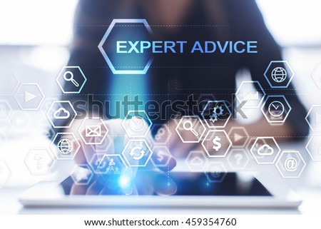 "Woman is using tablet pc, pressing on virtual screen and select ""Expert advice"". - stock photo"