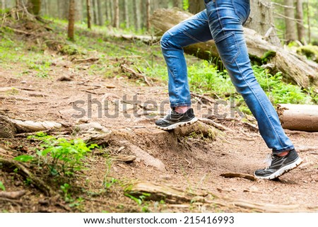 Woman is walking in the forest