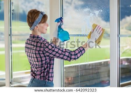 Woman washing window women short hair stock photo 642092323 woman is washing a window women with short hair clean a house malvernweather Choice Image