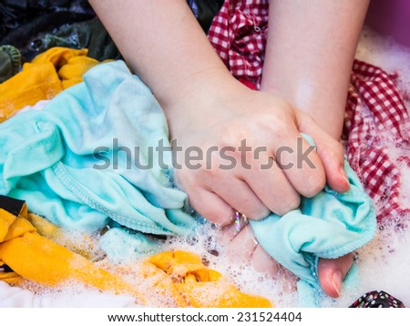 Woman is washing clothes - stock photo