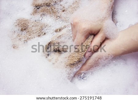 Woman is washing towel