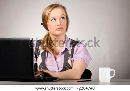 woman is working on laptop and thinking