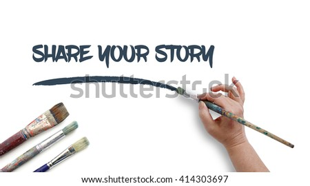Woman is writing SHARE YOUR STORY with paintbrush.