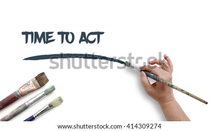 Woman is writing TIME TO ACT with paintbrush. - stock photo