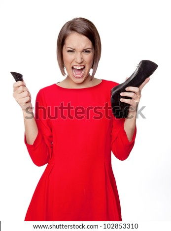 woman is yelling because of her broken shoe heel - stock photo