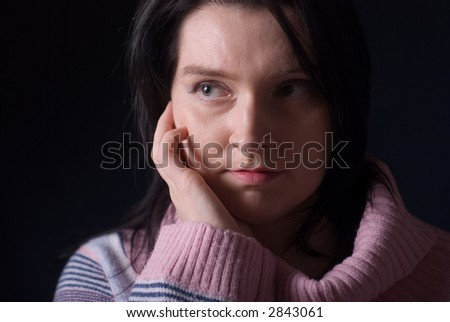 Woman isolated on dark background