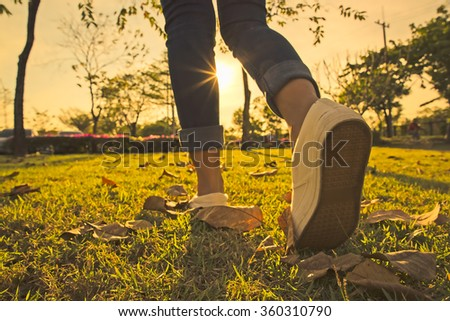 Woman jeans and sneaker shoes And sunset - stock photo