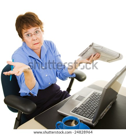 Woman job hunting in the newspaper and on-line and not finding anything.  Isolated on white. - stock photo