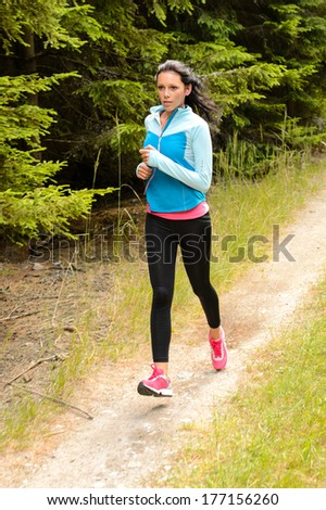 Woman jogging outdoor running on countryside path - stock photo