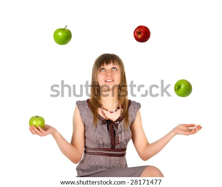 Woman juggling with apples. Isolated on white background - stock photo