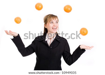 Woman juggling with oranges / multitasking - stock photo