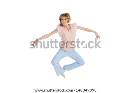 Woman jumping and opening arms on white background