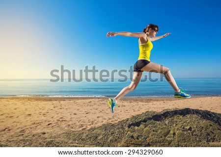 Woman jumping and running on beach. Girl running.