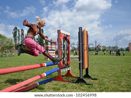 Woman jumping barrier - stock photo