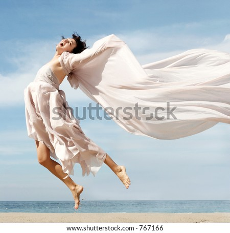 Woman jumping on the beach - stock photo