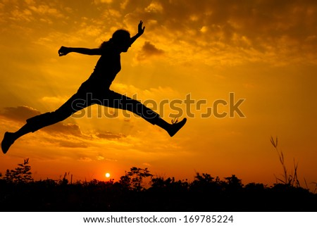 woman  jumping on the nature of the evening
