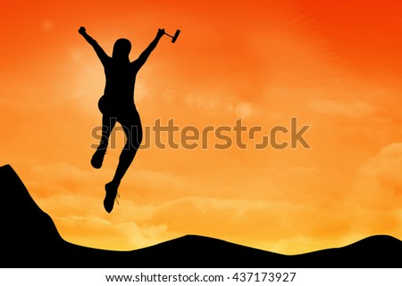Woman jumping with golf club against sky and mountain