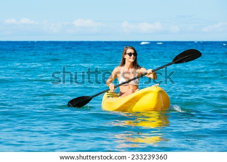Woman Kayaking in the Ocean on Vacation in Hawaii - stock photo