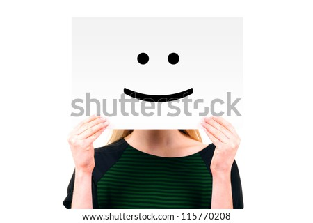 woman keeping a paper with smiling face - stock photo