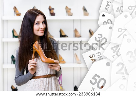 Woman keeping brown leather high heeled shoe on sale in shopping center - stock photo
