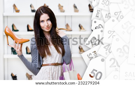 Woman keeping brown leather stylish pump on seasonal sale in shopping center - stock photo