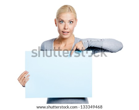 Woman keeps and points with hand at the copyspace, isolated on white - stock photo