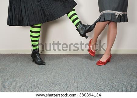 Woman kicking another woman - stock photo