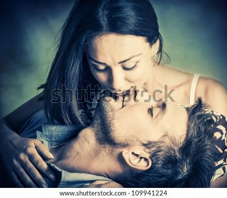 woman kissing her boyfriend in lips - stock photo