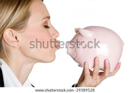 Woman Kissing Piggy Bank - stock photo