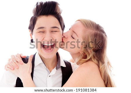 Woman kissing to her lesbian partner - stock photo