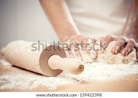 Woman kneading dough, close-up photo - stock photo