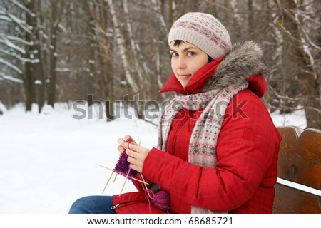Woman knitting outdoor - stock photo