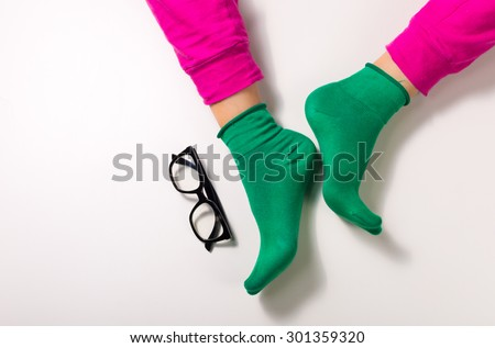 woman lag with colorful pants and socks isolated on white - stock photo