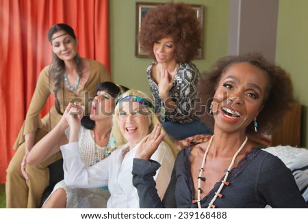 Woman laughing a middle aged group smoking pot - stock photo