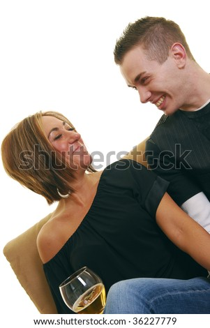 Woman laughing with boyfriend on sofa