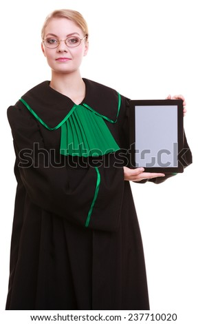 Woman lawyer attorney in classic polish gown holds tablet blank copy space. Technology. - stock photo