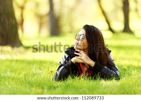 woman lay on green grass in park