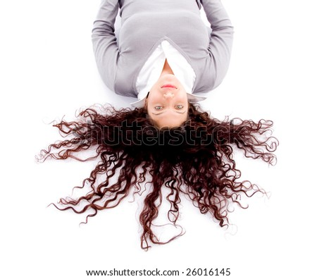 woman laying down on floor with hair spread out on white background - stock photo