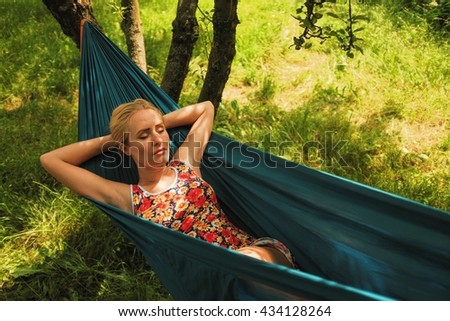 woman laying in hammock and daydreaming