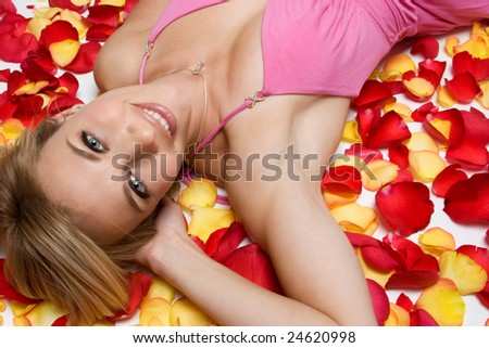 Woman Laying in Rose Petals - stock photo