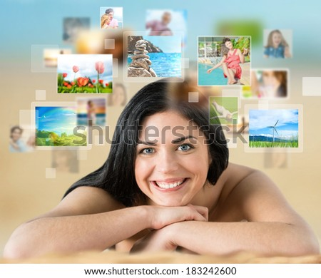 Woman laying on beach with lots of pictures around her. Cloud storage service, online sharing concept - stock photo
