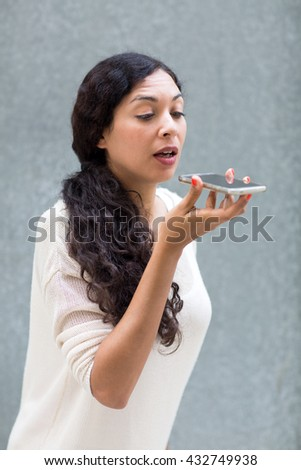 Woman leaving a voice massage on the phone - stock photo