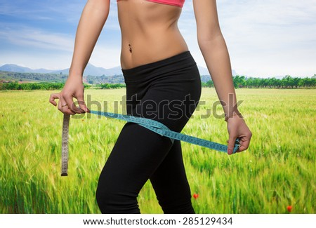 Woman leg close up with a measurement scale - stock photo