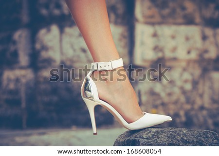 woman leg in high heel shoes outdoor shot - stock photo