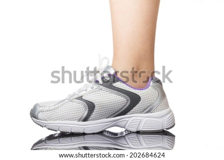 Woman leg with running shoes isolated on a white background.  - stock photo