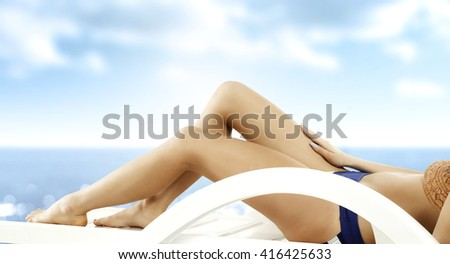 woman legs and chair and sky