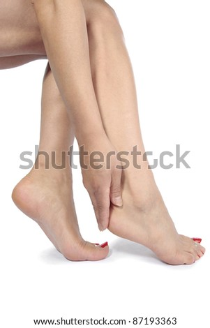 Woman legs and feet massaging aching feet